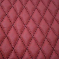 Quilted red leather with black single stitching