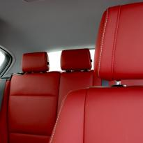 Bmw e87 sport nl dakota koral red with white stitching 003