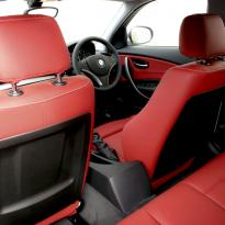 Bmw e87 sport nl dakota koral red with white stitching 011